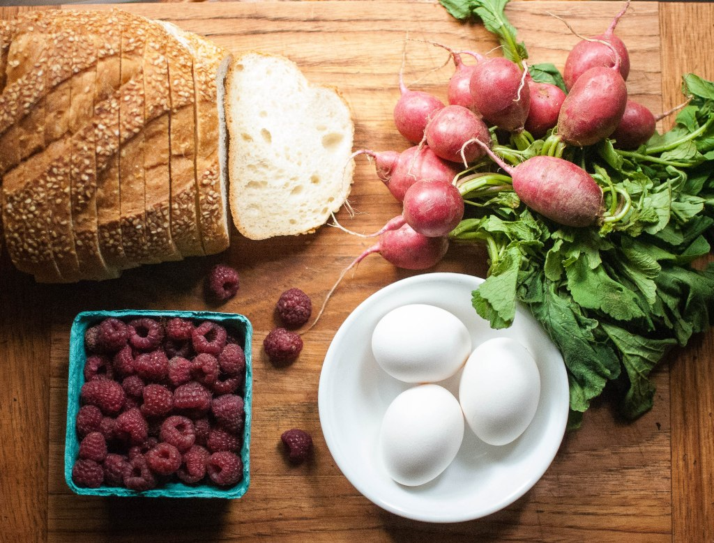 Semolina loaf, radishes, eggs, raspberries
