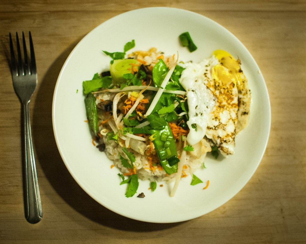 Top brown rice with sauteed veggies, fresh cilantro, and a fried or poached egg