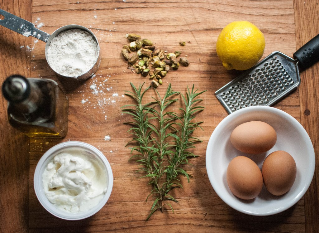 Flour, pistachios, lemon, eggs, rosemary, yogurt, olive oil