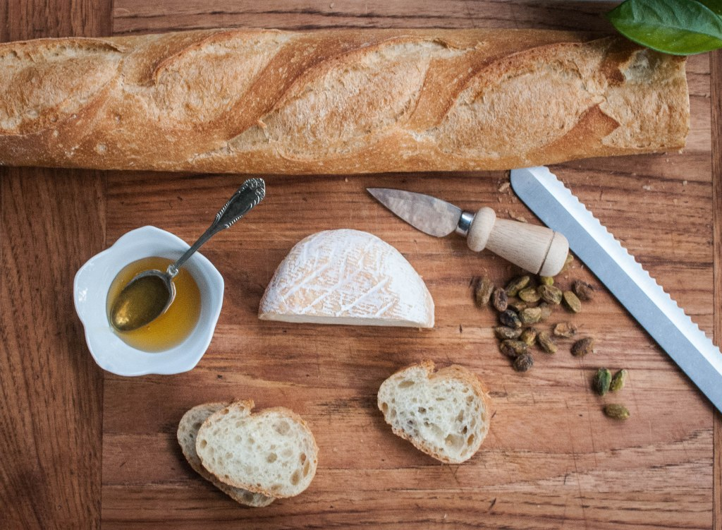 Baguette, pistachios, cheese, road-side honey from Ithaca