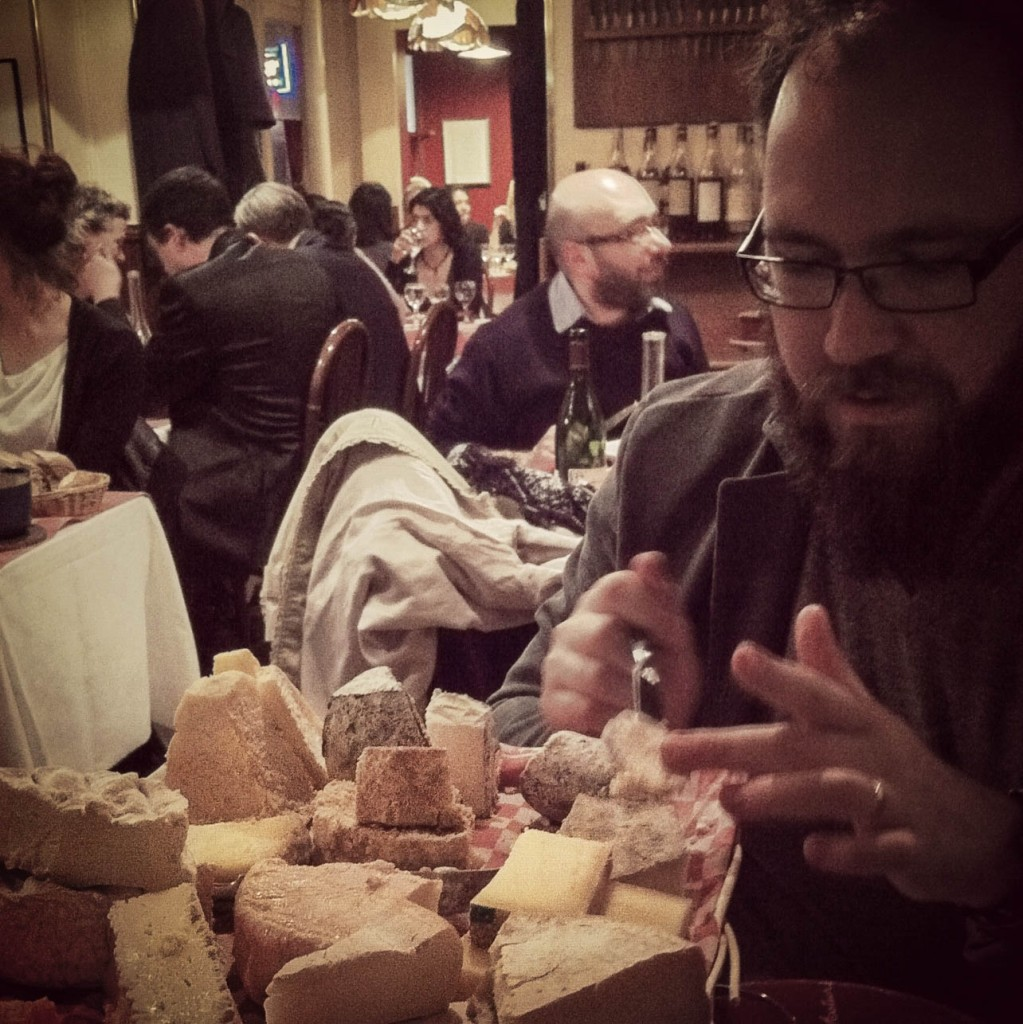 Digging in to a communal cheese platter in Paris