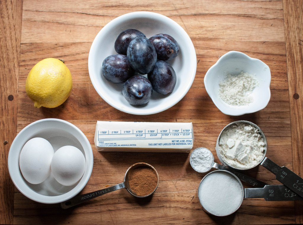Lemon, plums, salt, flour, baking soda, sugar, cinnamon, eggs, butter