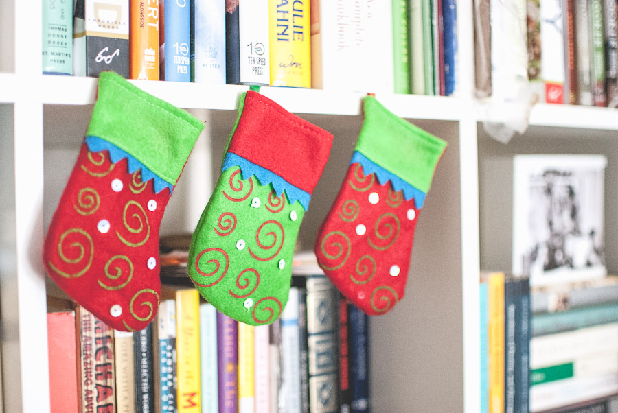 Tiny stockings hung from the bookshelves